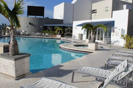 Stay in hotel/residence in Miami