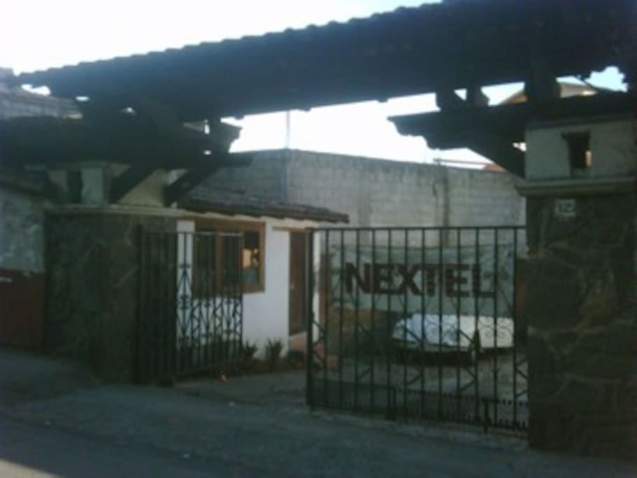 Street view entrance. House on right hand side, detached private room w/bathroom on the left. Carport capacity 3 cars.
