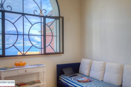 The villa is situated in one of the most characteristic areas of Old Gaeta. From the living room you can admire the Mediterranean sea but also the bell tower of the Cathedral of Sant Erasmo, standing at 57mts.