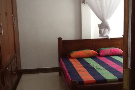 Hello..I am willing to provide you a fantastic home stay experience , be my guest and my family ,enjoy cooking with me, Big garden  room & bathroom , hot water,air cooler is provided, mosquito net. Include breakfast .can arrange tours to elephant orphanage , spice garden ,Air port pickup and drops etc...