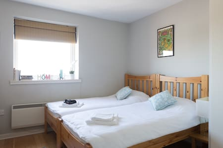 Quality, comfortable double/twin room with private bathroom in our city centre Galway apartment. The location is walking distance to all Galway sights and only 5 mins walk from bus/train station. Welcome to our home...