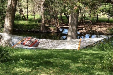 Looking for that special place next to a quiet river in a scenic part of the Texas Hill Country where you can lie in a shaded hammock and enjoy an afternoon nap? Located on the Sabinal River just outside of Utopia. Rates include 10% Occupancy tax.