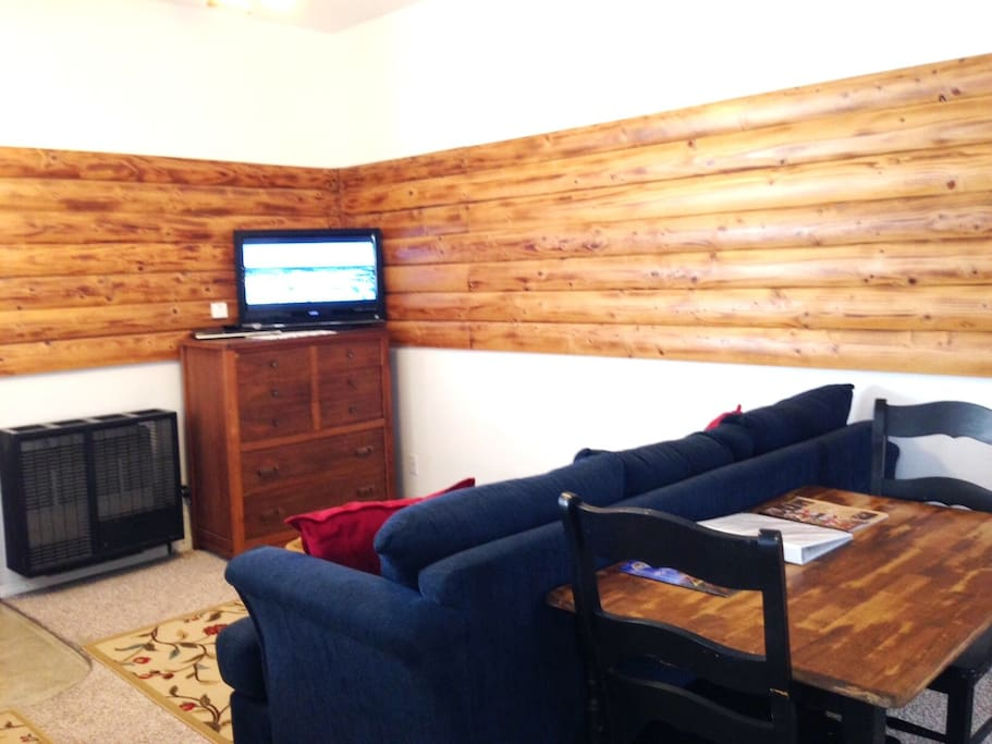 Sofa with LCD TV has cable & DVD player.