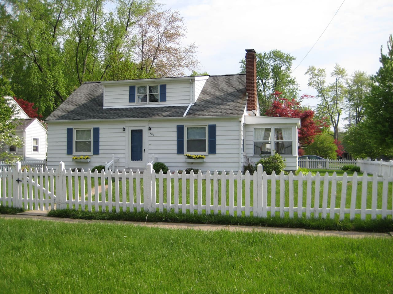 Adorable Professionally Decorated Home.  White Picket Fence Surrounds the Property