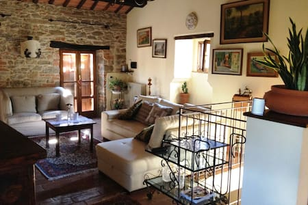 Stone-built farmhouse that has recently been restored with great care and is situated in the hills approximately three kilometres from Cortona. It is divided into two units that they can be rented separately or all. Encircled by a park of 5000 mq
