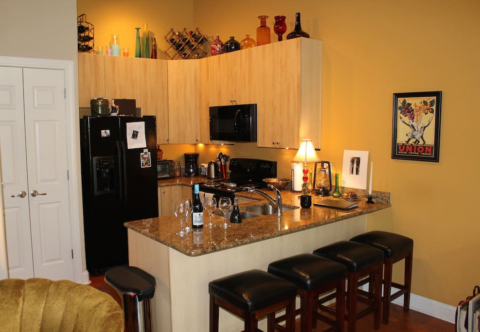 The kitchen overlooks both the condo's main living area and the Main St. Mall.