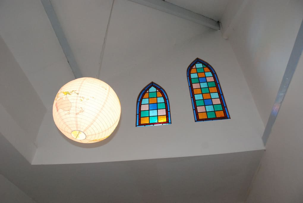 High ceiling with stained glass window feature