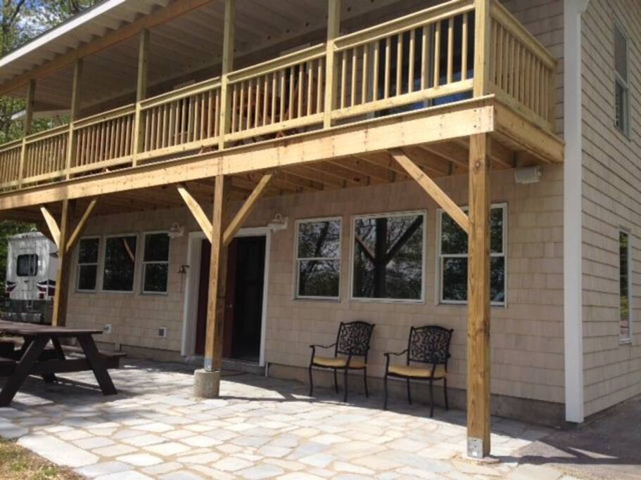 Sit on the deck or at the picnic table for wonderful views of Quahog Bay.
