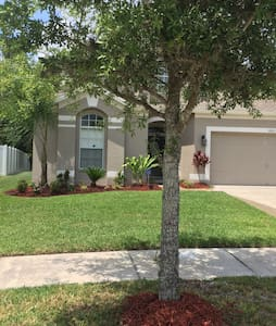 Beautiful Home Complete with Built In Wine Bar, Granite Counters, Wood & Marble Floors.  Flat Screen TV's in all the bedrooms and living spaces.  Lovely Neighborhood in Wesley Chapel Florida, a suburb of Tampa. Home can accommodate up to 10 guests.
