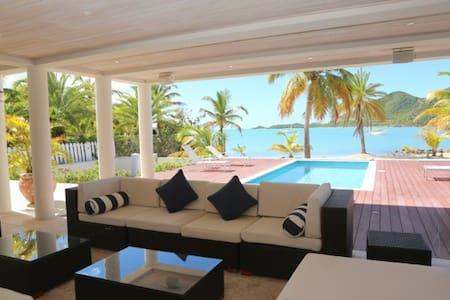 The property sprawls onto white sands and is merely a stones throw from the sparkling turquoise Caribbean Sea. Boasting a host of outdoor living areas, including a rooftop bar, and extensive deck with yacht mooring, this is truly an exceptional villa