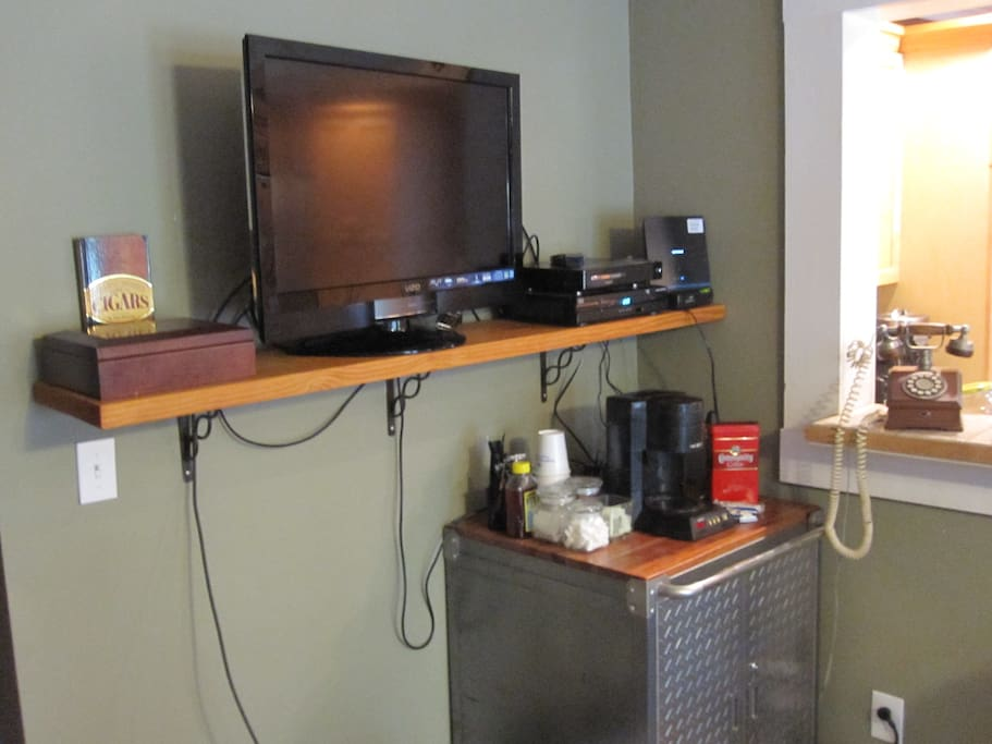 Dining room view of TV & coffee bar