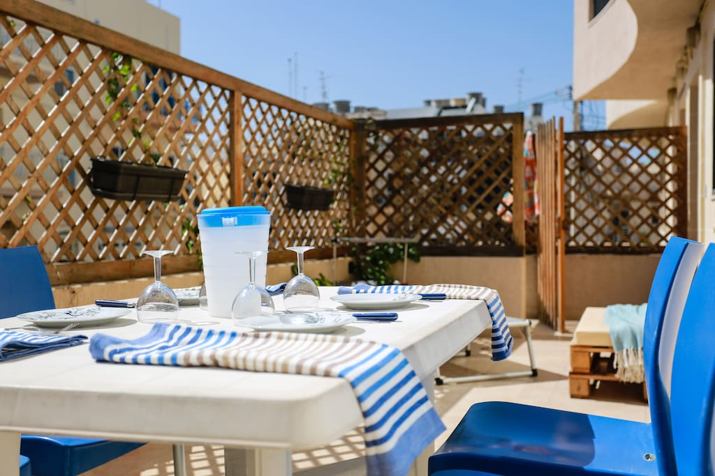 Sunny private terrace with dining facilities, BBQ and sunbeds