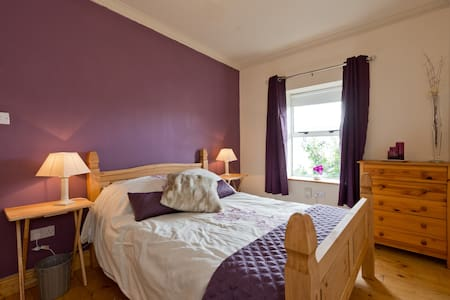 A newly decorated double bedroom with a shower room across the hall, there is a single airbed also available if there is need for a sleeping space for a third person or a child.