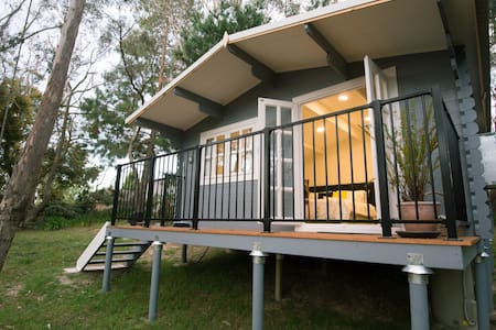 Cabin set in bush garden