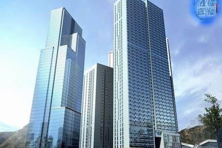 星海广场海边客栈酒店式公寓,24小时热水,80M免费WIFI,大床房