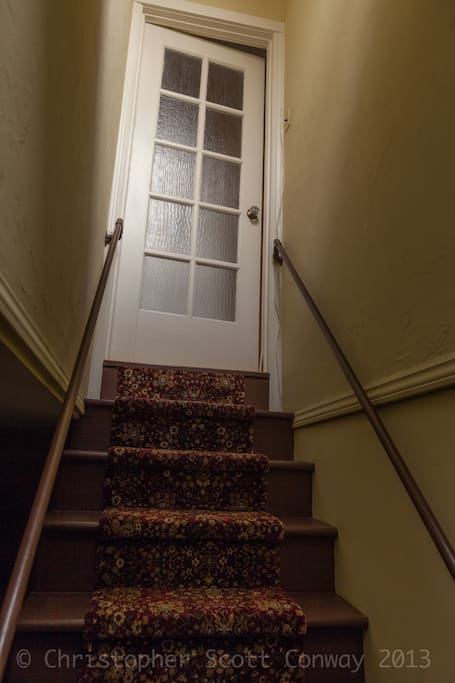 This is the stair entrance to the house upstairs from the downstairs entry. Its your access to the space.