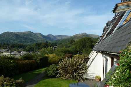 Luxury apartment central Ambleside. Spectacular views from lounge, bedroom and private balcony. Comfortably sleeps 4, fully equiped kitchen, dining area for 4, bathroom with bath and separate shower cubicle. Swimming pool/jacuzzi onsite. Free parking