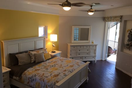 This sunshine suite has a king size bed and a double Murphy bed.  The suite has a morning room for the quick coffee and breakfast along with a balcony overlooking the pool and backyard.