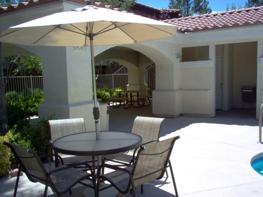 pool area table w umbrella
