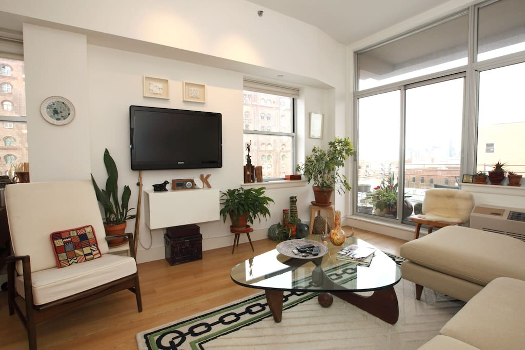 Living Room with views of Manhattan & the Williamsburg Bridge
