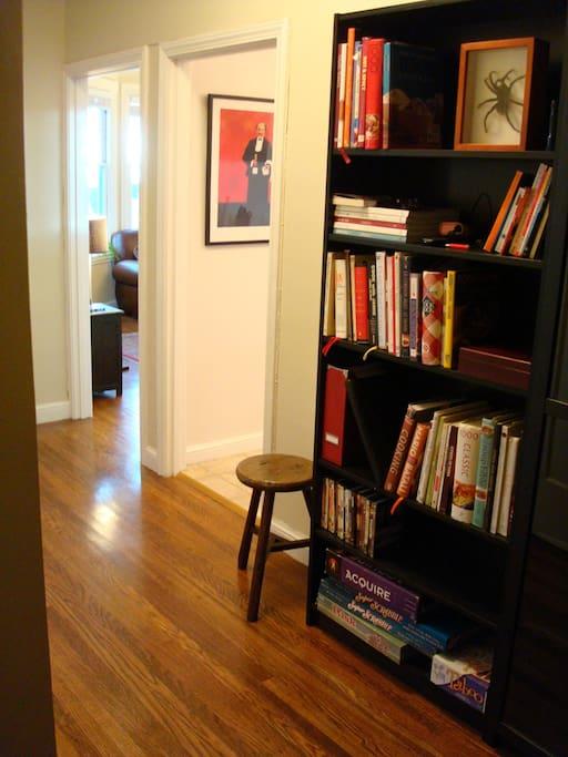 Hallway with book case.