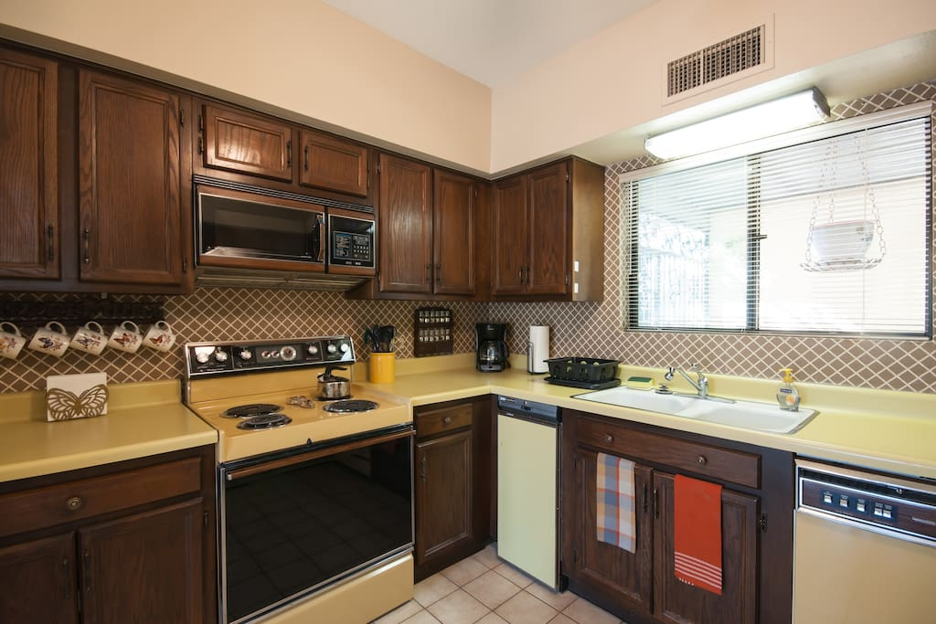 The kitchen includes a microwave, coffeemaker and toaster.