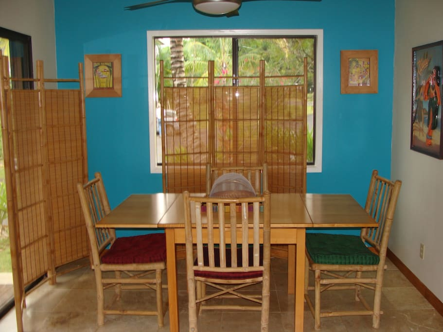 Dining area; lanai off to the left; yard in front