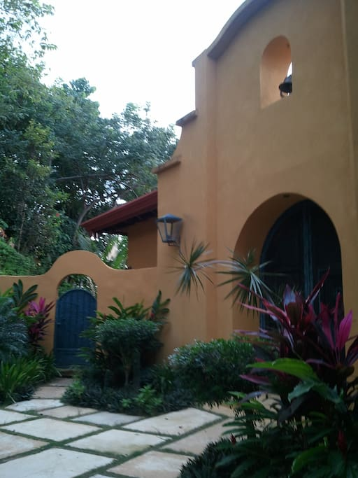 this is the front entrance to the mission style home