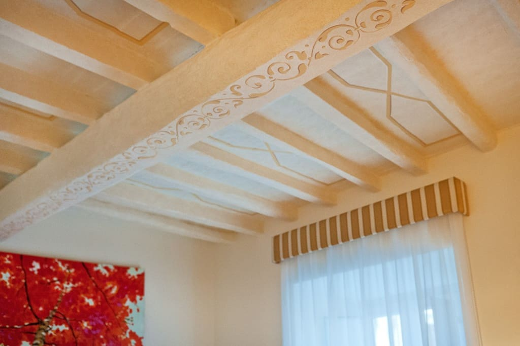 Bedroom 1: decorated beamed ceiling