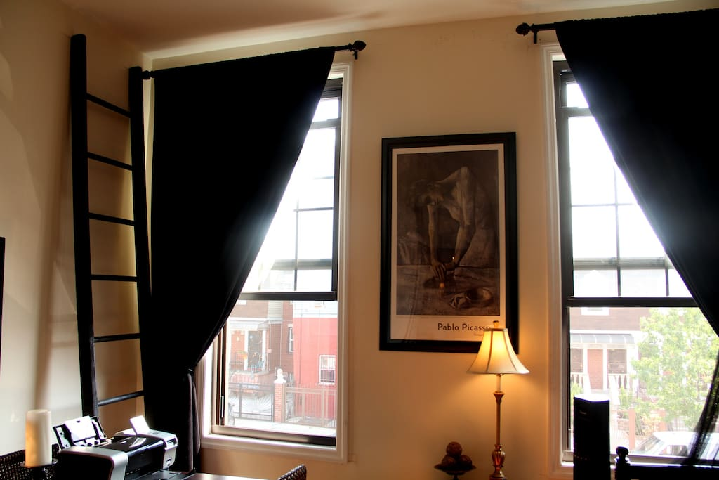 Lush velvet curtains and street view from guest room