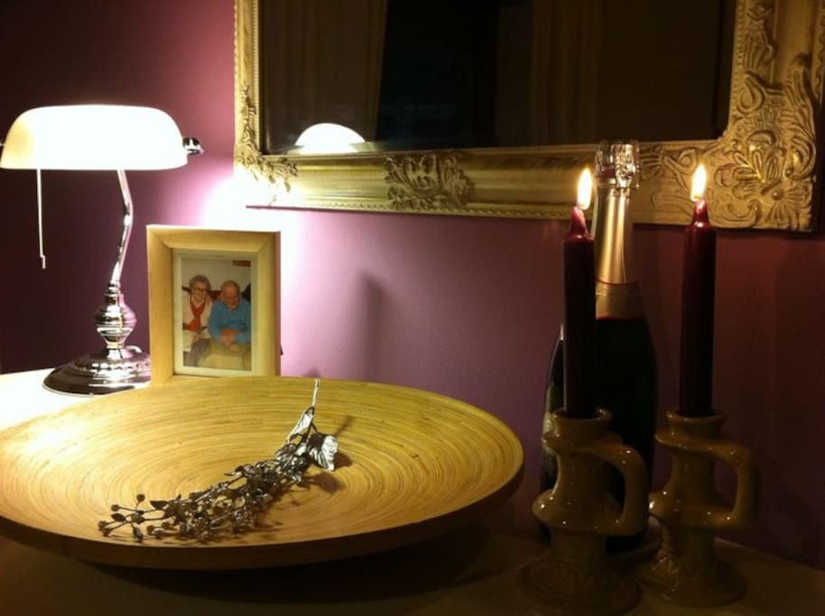 Juliana's lavender bedroom mirror. And candles. And champagne. Did anyone mention champagne?