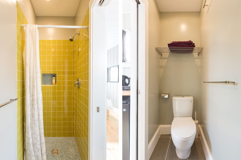 The toilet is dual-flush, water-saving; linens provided