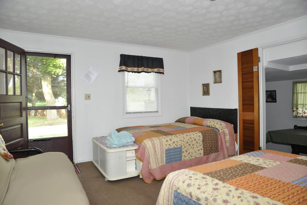 Bedroom with two full size beds & one full size futon sleeper sofa