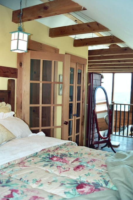 Bed Set Back in Private Nook in Open Loft with Skylights and Views