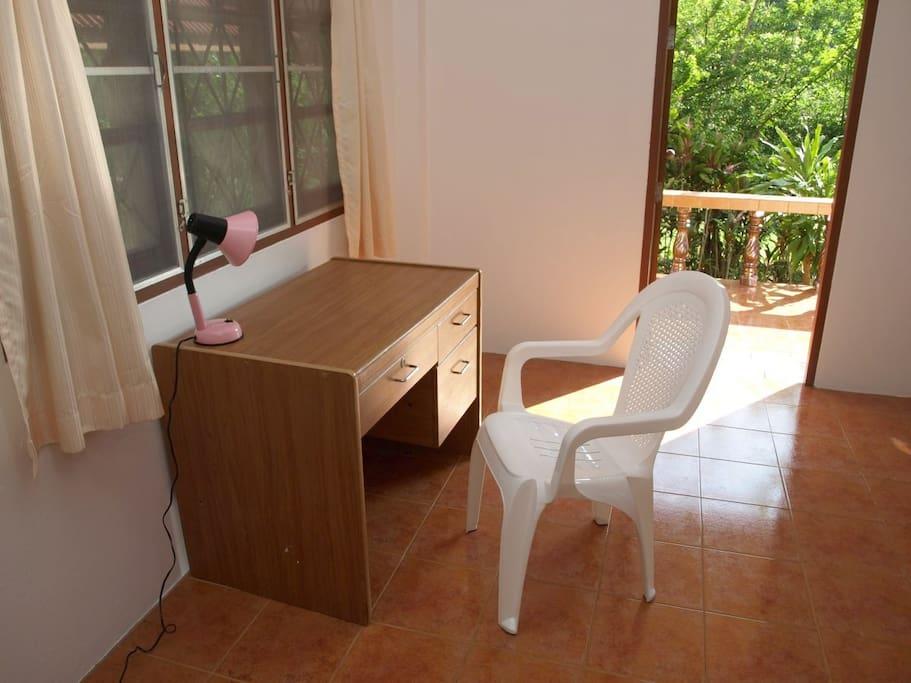 Desk with chair, lamp and garden view. High-speed WiFi Internet is included FREE.