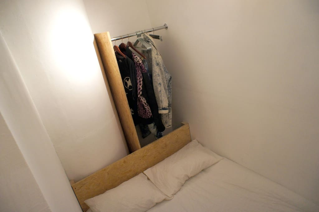 Here the view from above, you can store your case behind the bed with hanging space as shown.
