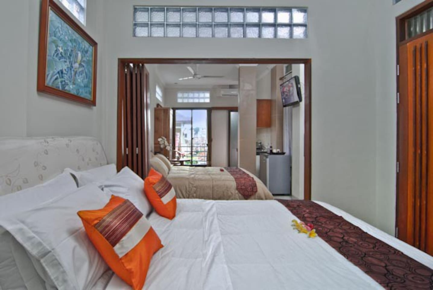 Suite Room: 2 BR with connecting door, with a kitchenette and 2 refridgerators, 2 LCD TV with intl channels, free WIFI , 2 ACs, hot water rainshower and small balcony