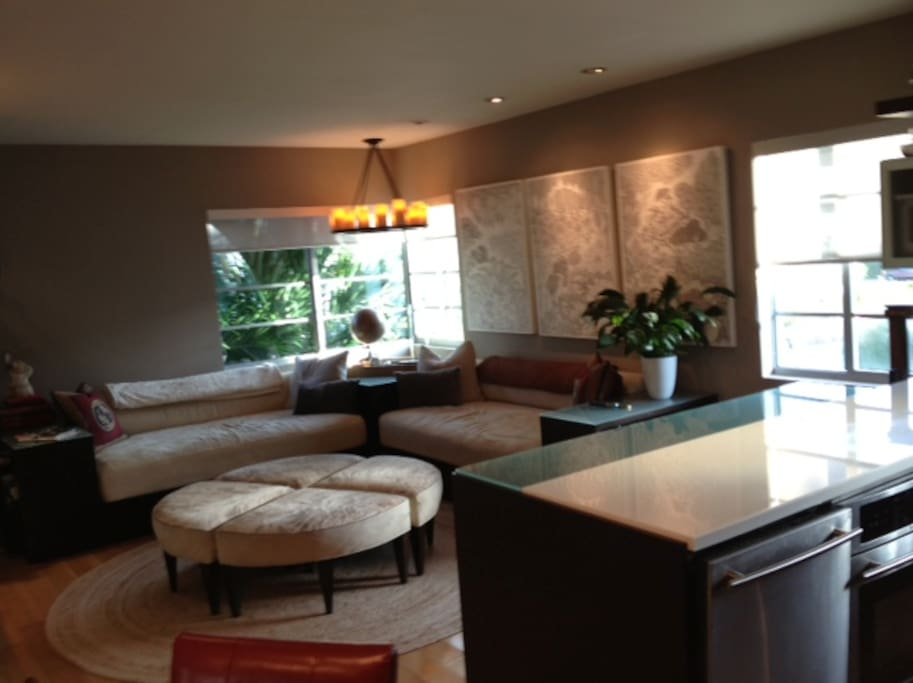 Open plan living room - bright lights - super size sofas perfect for relaxing after a long day at the beach!
