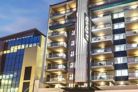 Executive One-Bedroom Apartment with Balcony - Apartment