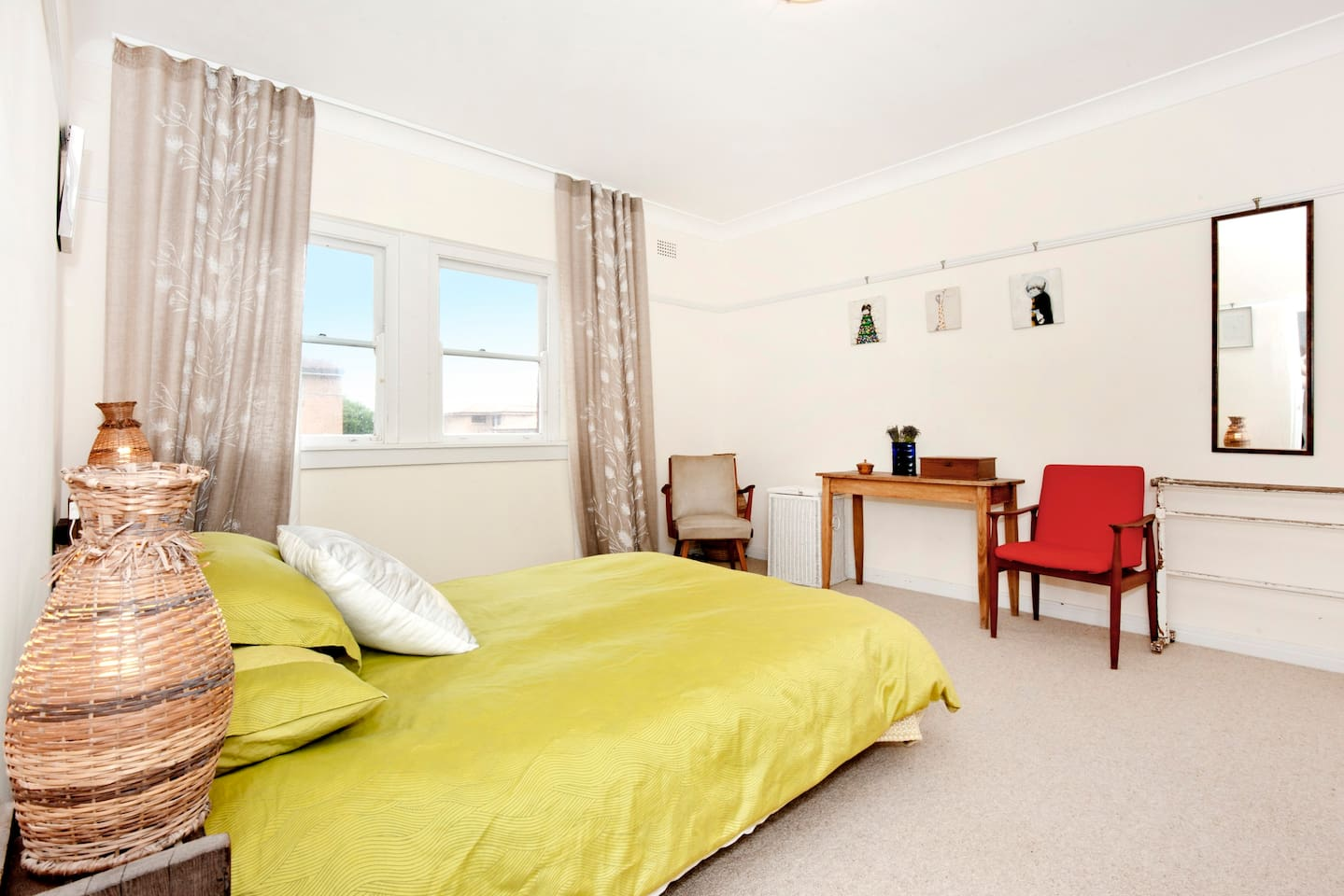 Main bedroom with queen sized bed, built in wardrobes and morning sun