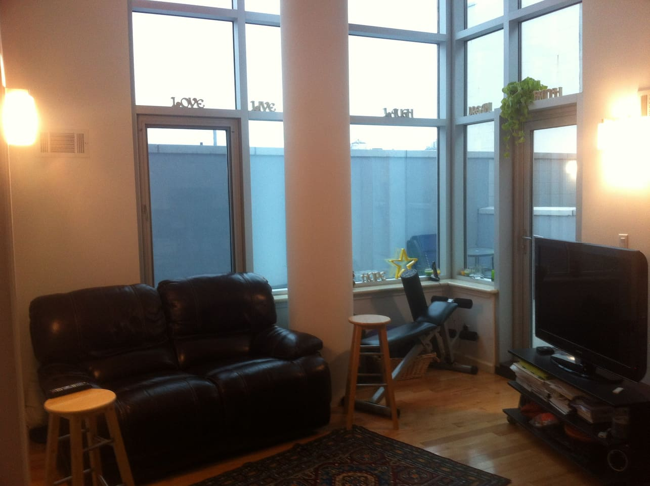 Living Room - 18 Foot Ceilings, Ceiling to Floor Windows. Beautiful Private Outdoor Space