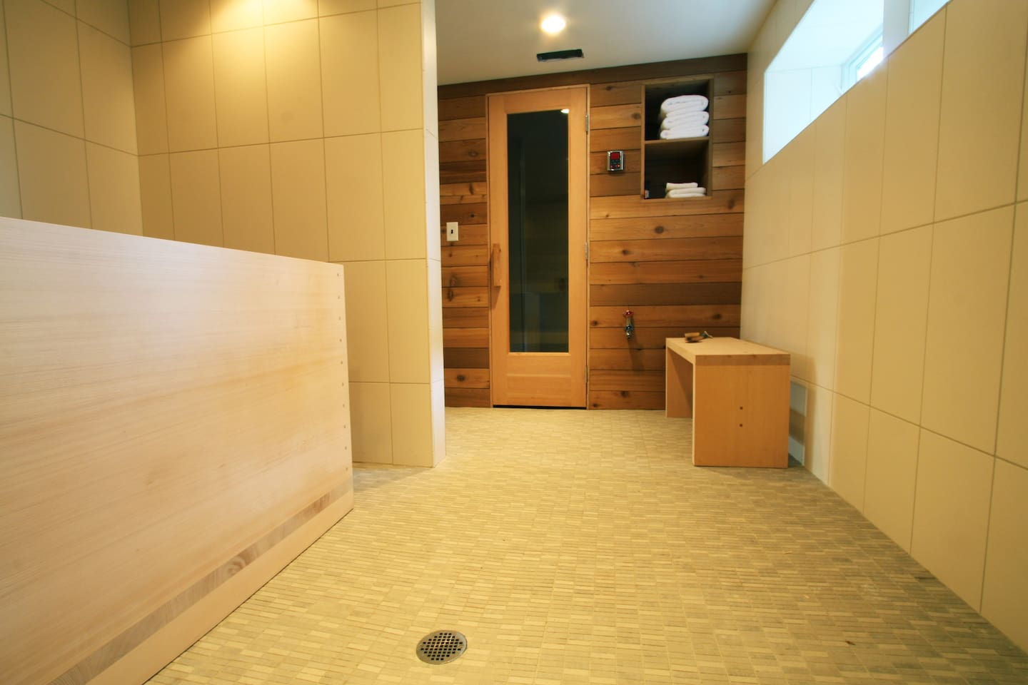 inside the spa looking at the Ofuro (japanese soaking tub) and the dry sauna.