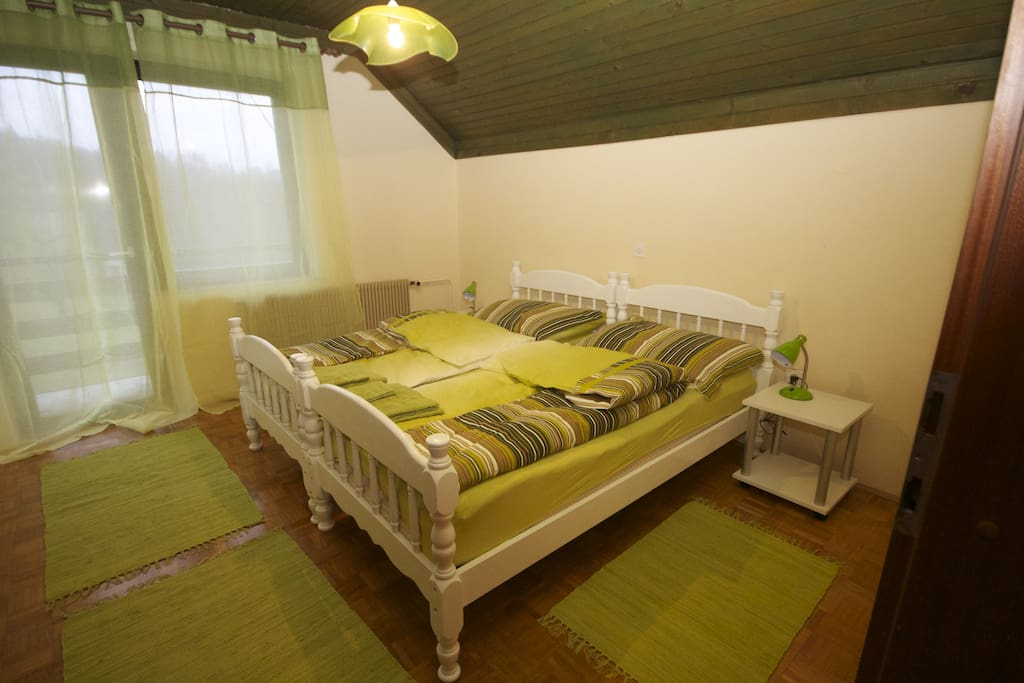 Bedroom with two single beds and private balcony
