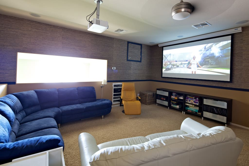 Want to be entertained? The game room is also a home theater.