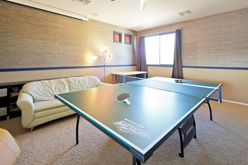 Competitive? We'll rearrange the furniture a little to set up the ping pong table and play a few rounds!