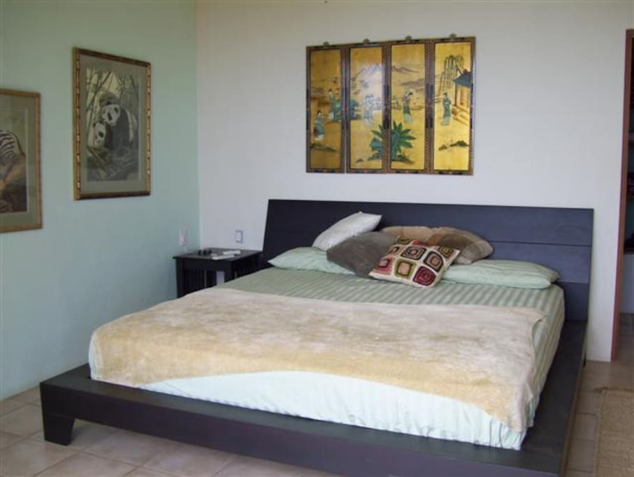 King Size Bed in guest room .