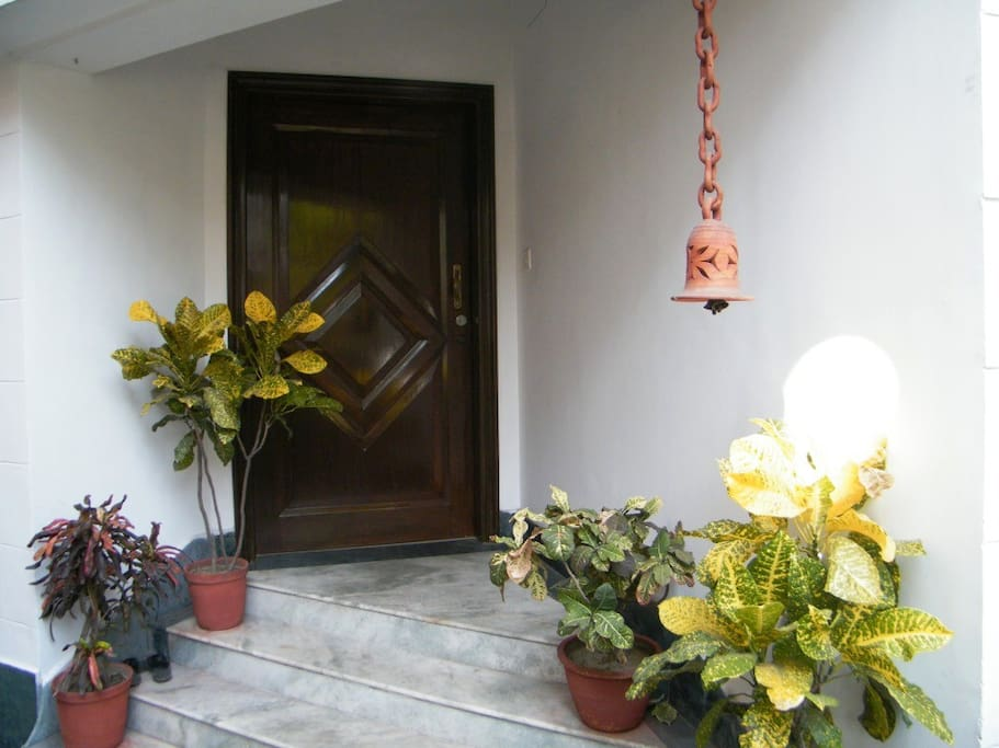 Entrance Portico with Marble Steps and Burma Teak Door