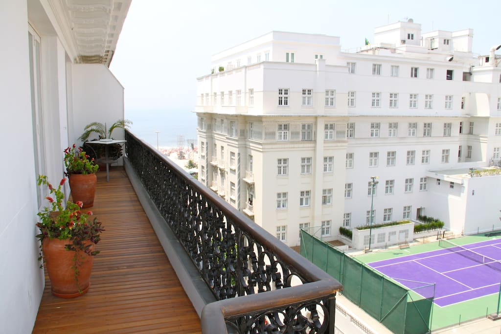* The balcony is enormous and wraps around the entire two sides. From one side you can see the mountains/city, from the other you can see the beach/ocean. There is a nice little chair/table set which is perfect for a morning or afternoon snack.