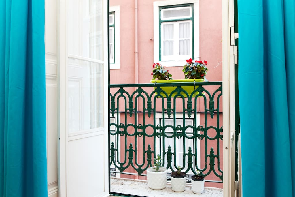 window with a litle terrace and flowers