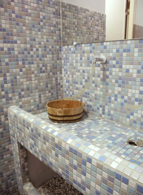new mosaic tiles give the old concrete basin a new look
